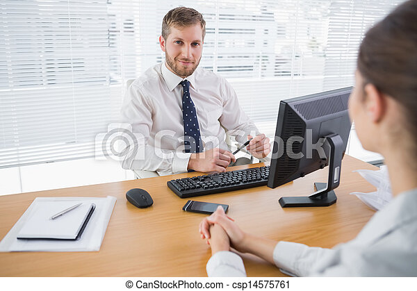 Businessman smiling at camera in his office - csp14575761