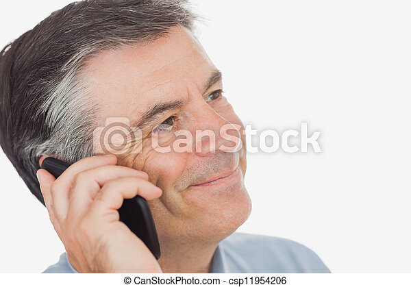 Businessman smiling while using mobile phone - csp11954206