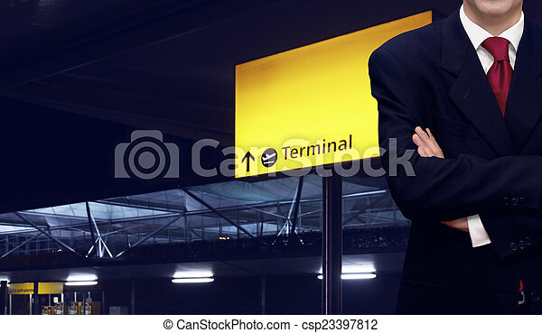 Businessman standing at the airport terminal - csp23397812