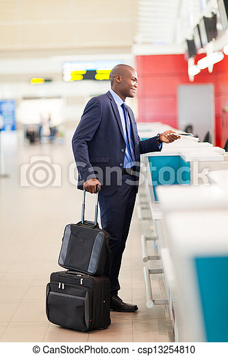 businessman standing by airport check in - csp13254810