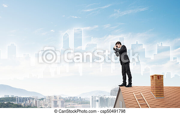 Businessman standing on roof and looking in binoculars. Mixed media - csp50491798