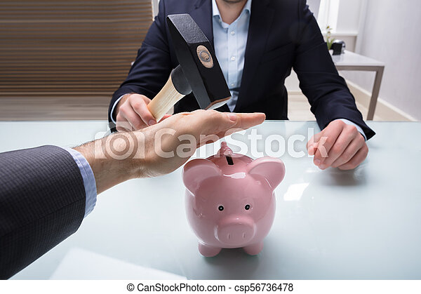 Businessman Stopping His Colleague From Breaking Piggybank - csp56736478