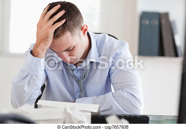 Businessman stressed while doing his accounting - csp7657938