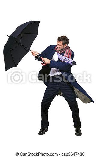 Businessman struggling with umbrella - csp3647430
