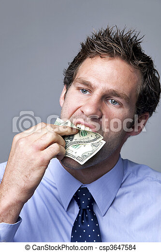 Businessman stuffing money in his mouth. - csp3647584