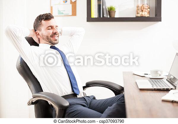 Businessman taking a break from work - csp37093790