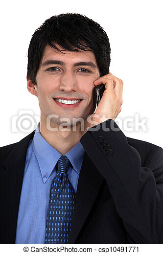 Businessman talking on his mobile phone - csp10491771