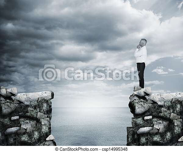 Businessman thinking at the edge of - csp14995348