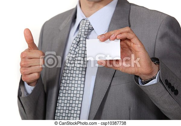 businessman thumb up showing business card - csp10387738