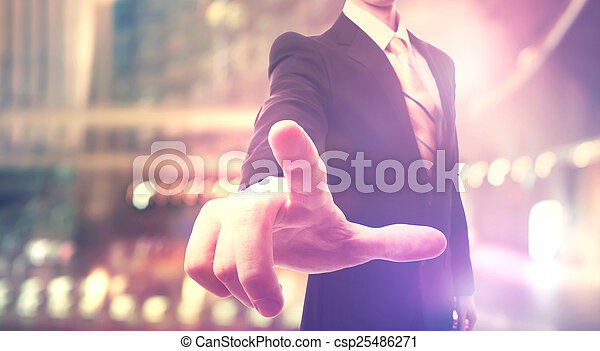 Businessman touching a touch screen - csp25486271