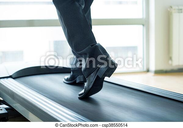 Businessman training in gym - csp38550514