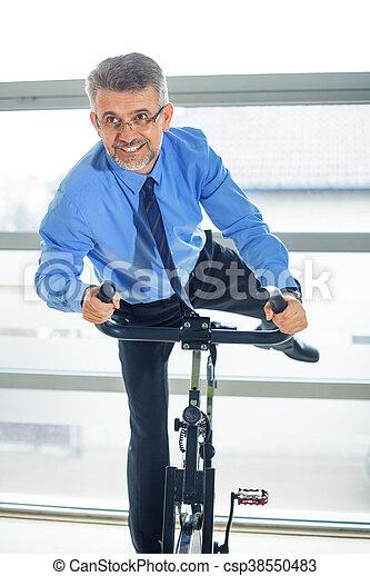 Businessman training in gym - csp38550483