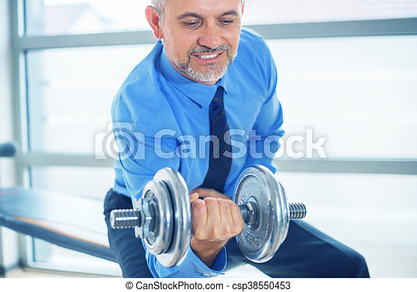 Businessman training in gym - csp38550453