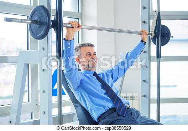Businessman training in gym - csp38550529