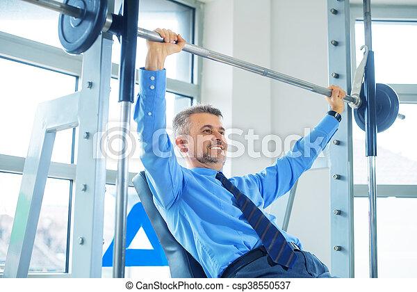 Businessman training in gym - csp38550537