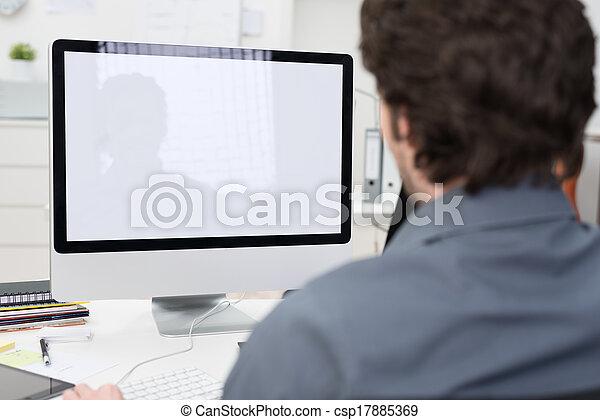 Businessman using a desktop computer - csp17885369