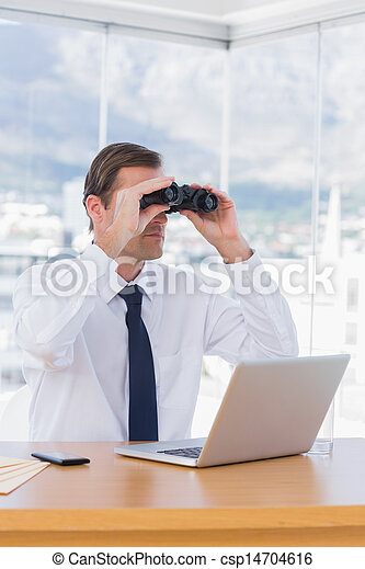 Businessman using binoculars while he is working - csp14704616