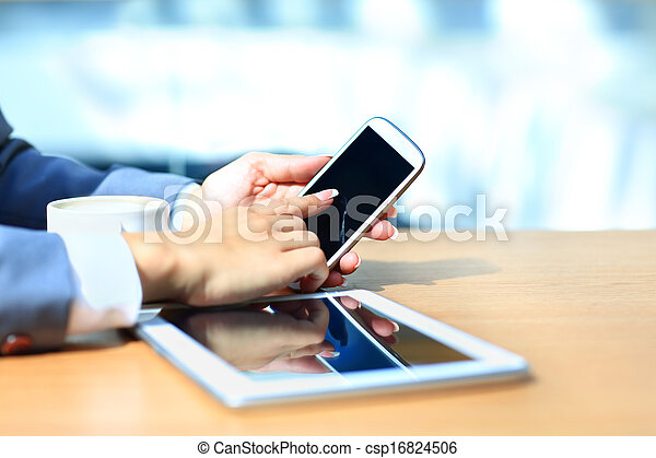 Businessman using digital tablet computer with modern mobile phone. New technologies for success workflow concept. - csp16824506