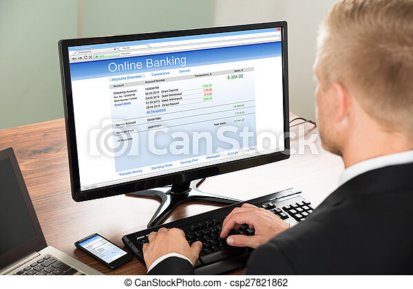 Businessman Using Online Banking Service - csp27821862
