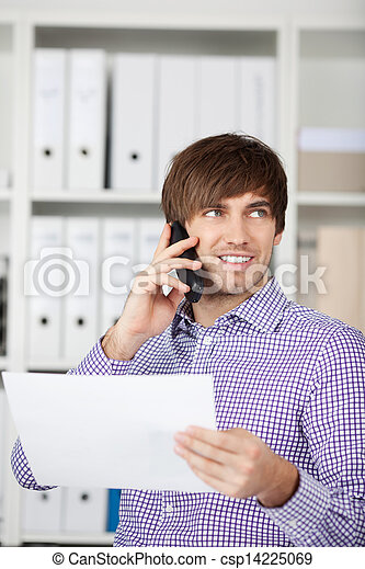Businessman Using Phone In Office - csp14225069
