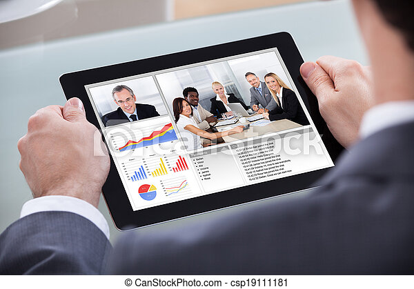 Businessman Video Conferencing With Co-worker - csp19111181