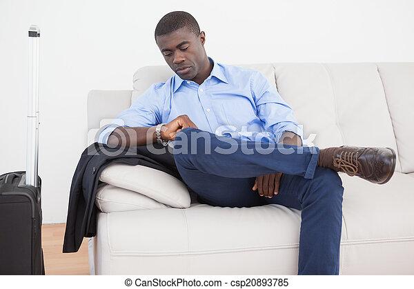 Businessman waiting for a flight - csp20893785