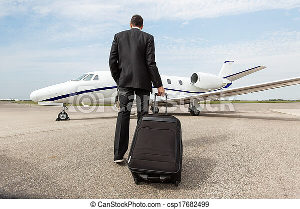 Businessman Walking Towards Corporate Jet - csp17682499