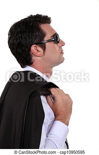 businessman wearing sunglasses posing in profile - csp10950595