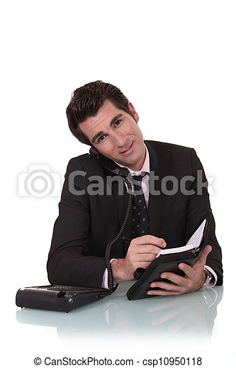 Businessman with a diary and phone - csp10950118