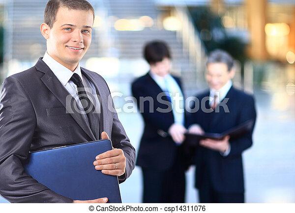 Businessman with a laptop. - csp14311076