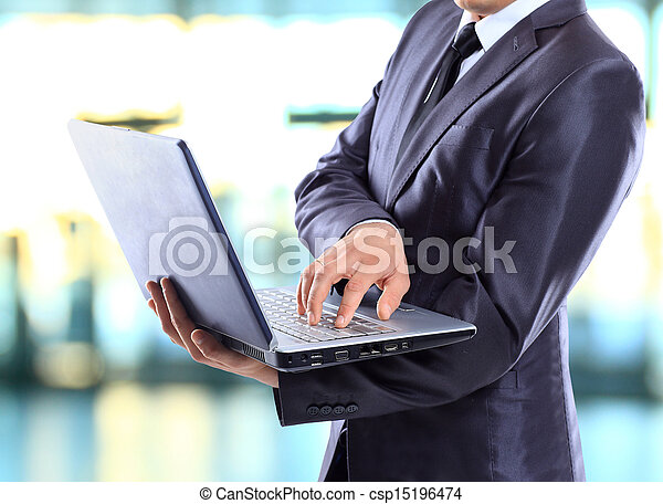 Businessman with a laptop. - csp15196474