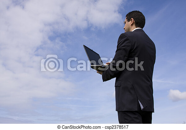 Businessman with a laptop - csp2378517