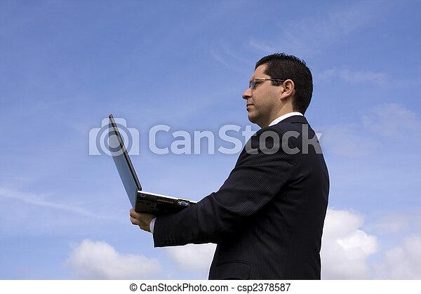 Businessman with a laptop - csp2378587