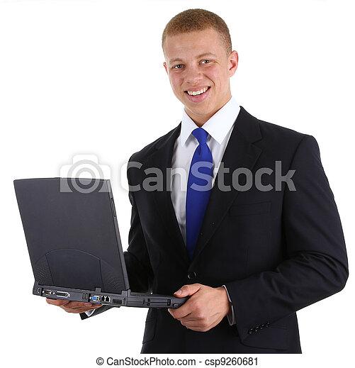 Businessman with a laptop - csp9260681