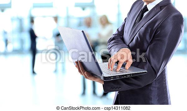Businessman with a laptop. - csp14311082