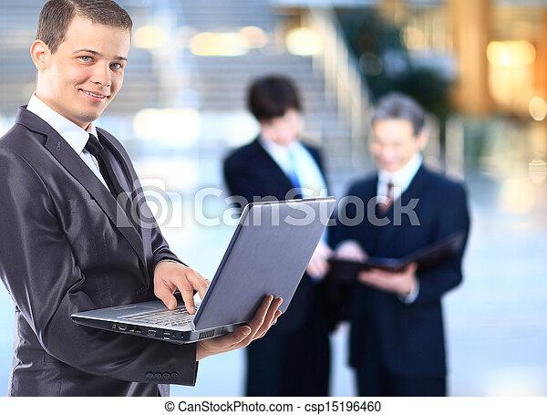 Businessman with a laptop.  - csp15196460