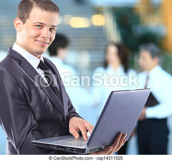 Businessman with a laptop. - csp14311025
