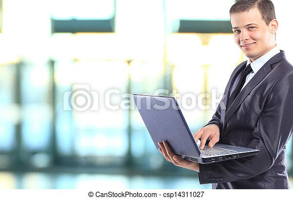 Businessman with a laptop. - csp14311027