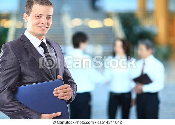 Businessman with a laptop. - csp14311042