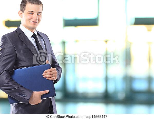 Businessman with a laptop. - csp14565447
