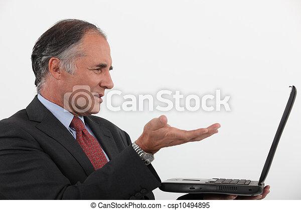 Businessman with a laptop - csp10494895