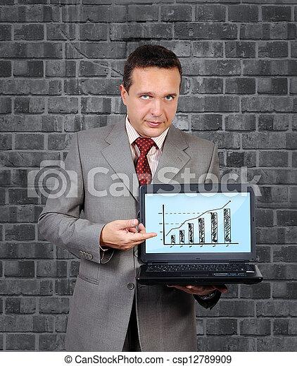 businessman with a laptop - csp12789909