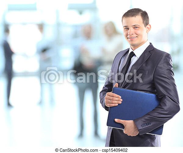 Businessman with a laptop.  - csp15409402
