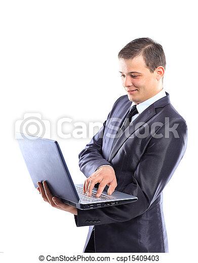 Businessman with a laptop. - csp15409403