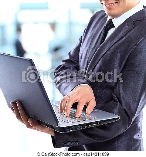 Businessman with a laptop. - csp14311039