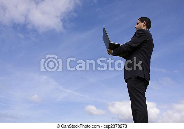 Businessman with a laptop - csp2378273