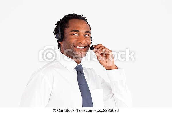 Businessman with aheadset smiling  - csp2223673