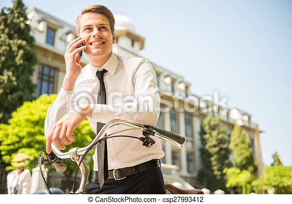 Businessman with bicycle - csp27993412