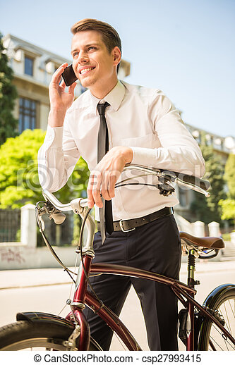 Businessman with bicycle - csp27993415