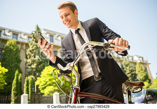 Businessman with bicycle - csp27993429